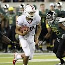 Arizona quarterback Matt Scott finds a hole in the line during the first half of their NCAA college football game against Oregon in Eugene, Ore., Saturday, Sept. 22, 2012. (AP Photo/Don Ryan)