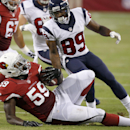 Arizona Cardinals' Marcus Benard (59) intercepts a pass intended for Houston Texans' Mike Thomas (89) during the first half of an NFL preseason football game Saturday, Aug. 9, 2014, in Glendale, Ariz The Associated Press