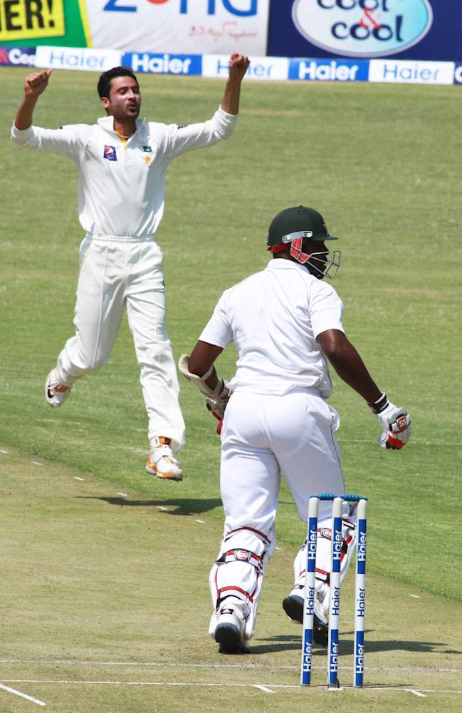 Pakistan bowler Junaid Khan, right, reacts after  bowling as Zimbabwean batsman Hamilton Masakadza looks on, on the first day of the  last  test match   against Zimbabwe at Harare Sports Club  in Harare, Tuesday, Sept, 10, 2013. Pakistan is in Zimbabwe  to play Test matches against the hosts