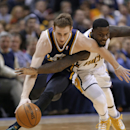 Indiana Pacers guard Lance Stephenson, right, fouls Utah Jazz guard Gordon Hayward as they go for a loose ball during the first half of an NBA basketball game in Indianapolis, Sunday, March 2, 2014 The Associated Press