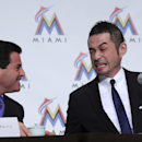 Ichiro Suzuki, right, and Miami Marlins president David Samson speak during a news conference in Tokyo Thursday, Jan. 29, 2015. Ichiro says a renewed sense of enthusiasm was behind his decision to sign a $2 million, one-year contract with the Miami Marlin