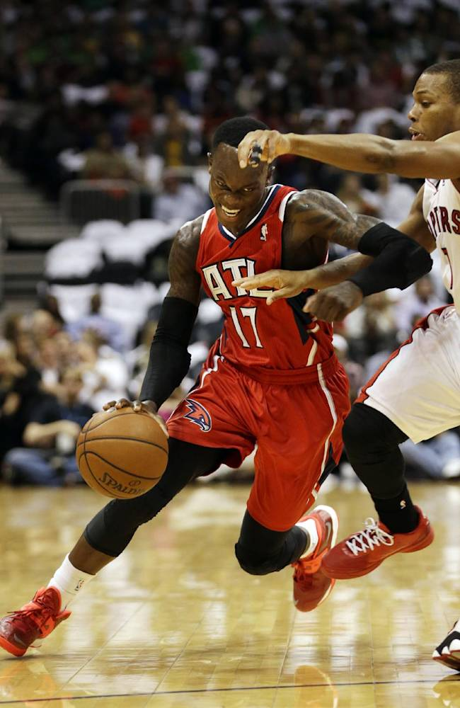 Atlanta Hawks point guard Dennis Schroder (17), of Germany, drives against Toronto Raptors point guard Kyle Lowry in the first half of an NBA basketball game Friday, Nov. 1, 2013, in Atlanta