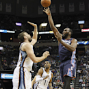 Charlotte Bobcats center Al Jefferson (25) shoots against Memphis Grizzlies center Marc Gasol, left, of Spain, and Mike Conley in the first half of an NBA basketball game Saturday, March 8, 2014, in Memphis, Tenn The Associated Press