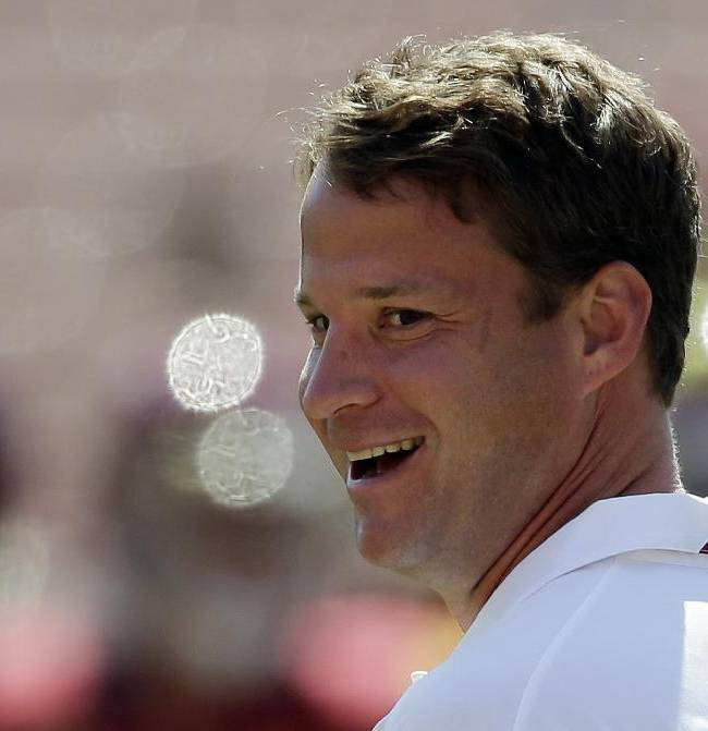 Southern California coach Lane Kiffin smiles during warms ups before an NCAA college football game against Boston College in Los Angeles, Saturday, Sept. 14, 2013