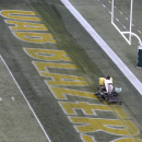 FILE - In this Nov. 22, 2014 file photo, a worker erases the UAB Blazers logo from the end zone after the final home game of the season at Legion Field in Birmingham, Ala. UAB president Ray Watts is bringing the football program back. He told The Associated Press that he decided on Monday, June 1, 2015 to reverse the earlier decision after meetings with UAB supporters continued through the weekend. He says donors have pledged to make up the estimated $17.2 million deficit over the next five years if football is restored. (AP Photo/ AL.com, Mark Almond, File)