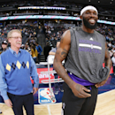 Newly-acquired Sacramento Kings forward Reggie Evans, right, jokes with Denver Nuggets had trainer Jim Gillen before the start of an NBA basketball game against the Denver Nuggets in Denver on Sunday, Feb. 23, 2014. Evans once played for the Nuggets The A