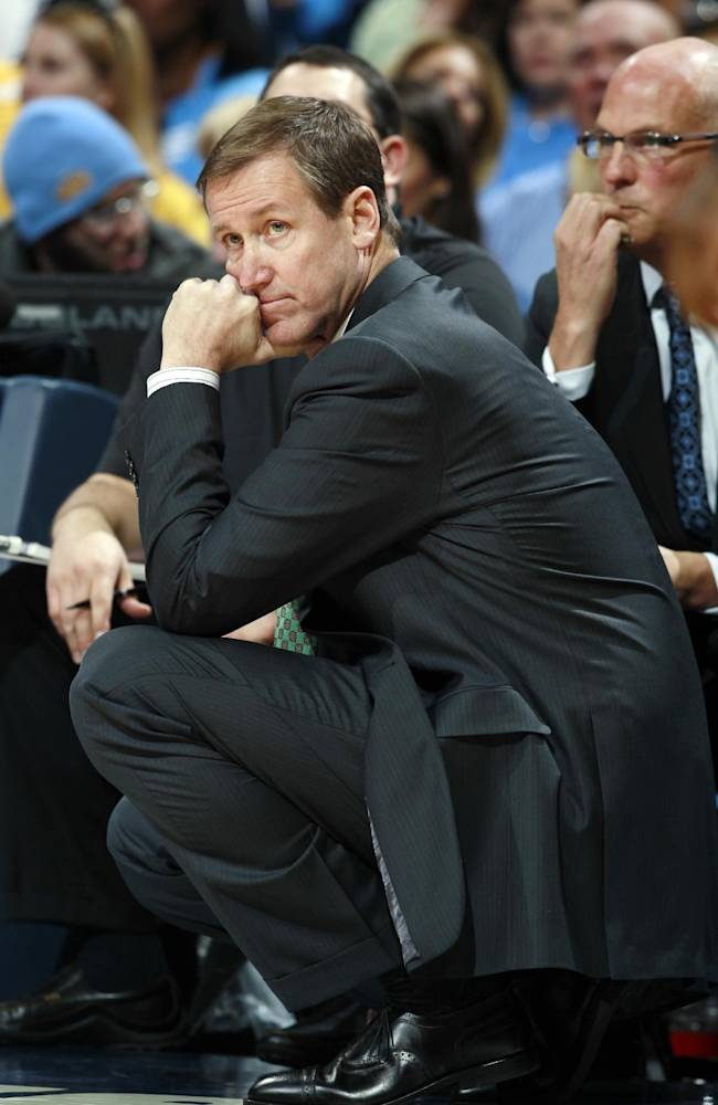 Portland Trail Blazers head coach Terry Stotts watches his team against the Denver Nuggets in the fourth quarter of Portland's 113-98 victory in an NBA basketball game in Denver on Friday, Nov. 1, 2013