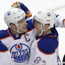 Edmonton Oilers Andrew Ference (21) celebrates scoring a goal with teammate Ales Hemsky (83) during the third period of an NHL hockey game Sunday, Dec. 1, 2013, in Dallas. The Oilers won 3-2 in a shootout The Associated Press