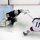 Columbus Blue Jackets' Matt Calvert (11) scores on Pittsburgh Penguins goalie Marc-Andre Fleury (29) in the second period of a first-round NHL playoff hockey game in Pittsburgh Saturday, April 19, 2014. Calvert had the game-winner in double overtime to le