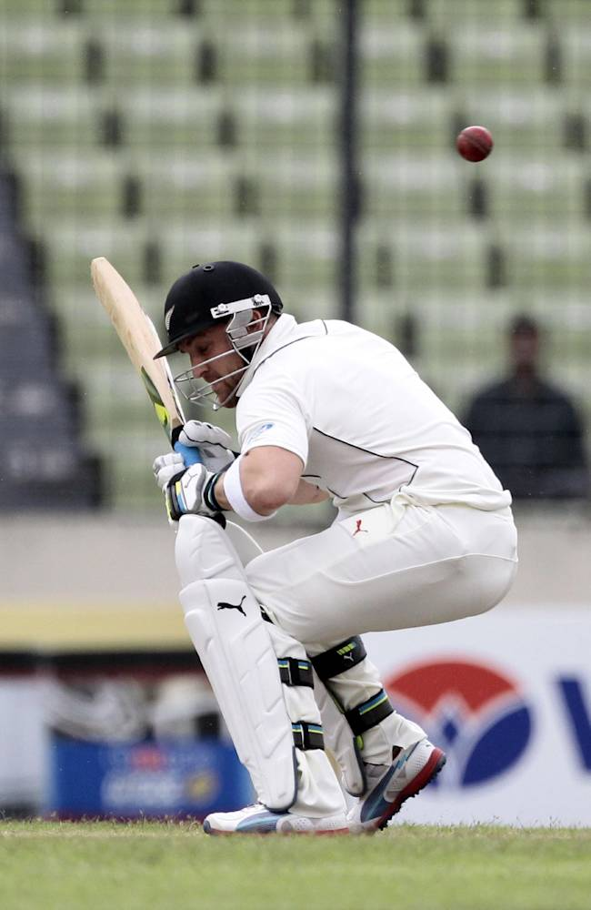 New Zealand's Brendon McCullum avoids a bouncer during the second day of the second cricket test match against Bangladesh in Dhaka, Bangladesh, Tuesday, Oct. 22, 2013