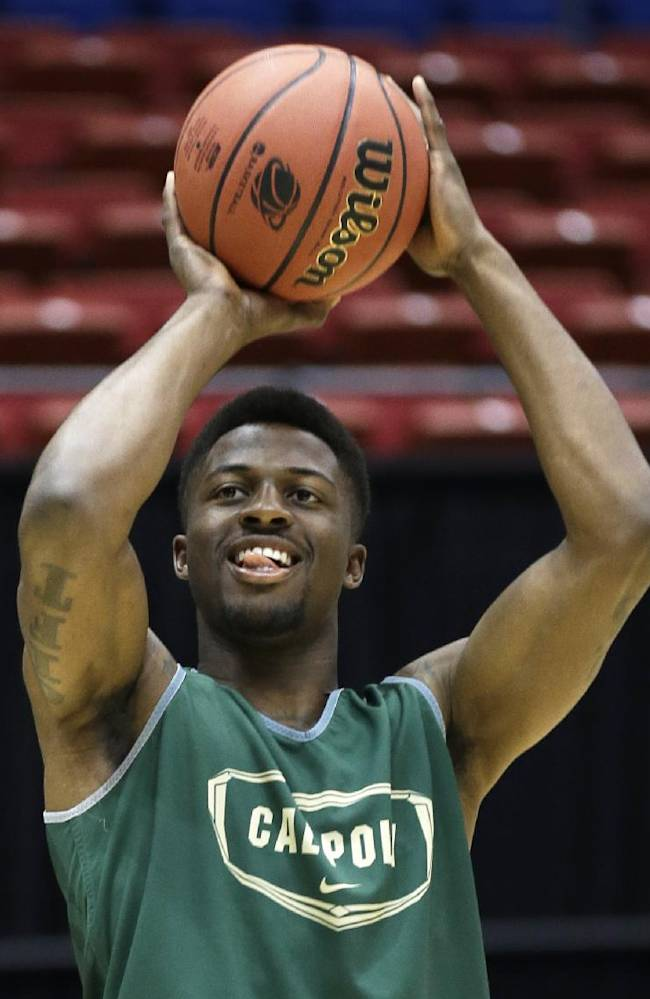 Cal Poly guard Dave Nwaba shoots during practice for an NCAA college basketball tournament game, Tuesday, March 18, 2014, in Dayton, Ohio. Cal Poly plays Texas Southern Wednesday evening in a first round game