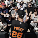 San Francisco Giants catcher Buster Posey, below, signs autographs before playing the Colorado Rockies in an exhibition spring training baseball game Tuesday, March 4, 2014, in Scottsdale, Ariz The Associated Press