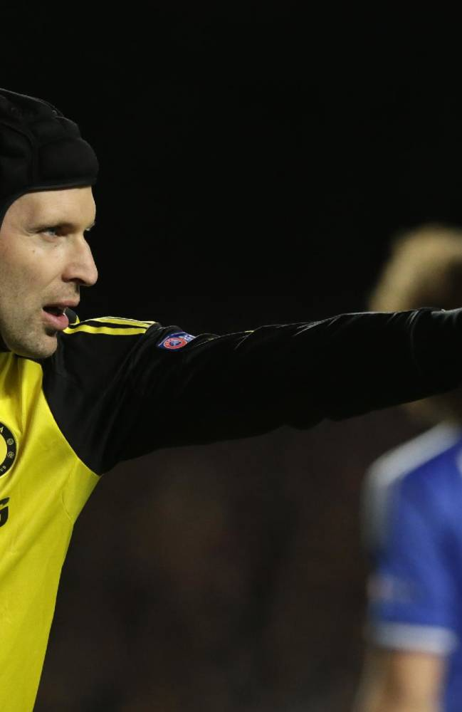 Chelsea goalkeeper Petr Cech pouts to his teammates during the Champions League quarterfinal second leg soccer match between Chelsea and Paris Saint Germain at Stamford Bridge stadium in London, Tuesday, April 8, 2014