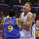 Los Angeles Clippers forward Blake Griffin, right, is fouled by Golden State Warriors forward Andre Iguodala during the first half in Game 2 of an opening-round NBA basketball playoff series in Los Angeles, Monday, April 21, 2014 The Associated Press