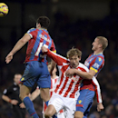 Crystal Palace's Mile Jedinak, left, and Brede Hangeland, right, crowd out Stoke City's Peter Crouch, during their English Premier League soccer match at Selhurst Park, London, Saturday Dec. 13, 2014