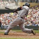 Boston Red Sox Dustin Pedroia (15) hits an RBI as he grounds into a fielder's choice against Minnesota Twins starting pitcher Pedro Hernandez during the third inning of a baseball game, Sunday, May 19, 2013, in Minneapolis. (AP Photo/Genevieve Ross)