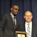 Michigan's Tim Hardaway Jr. accepts the Rudy Tomjanovich Most Improved Player award from head coach John Beilein during the NCAA college basketball team's annual post-season Michigan Basketball Awards Celebration on Tuesday, April 16, 2013, in Ann Arbor, Mich. (AP Photo/Detroit News, John T. Greilick)