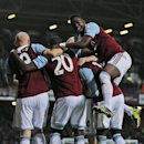 West Ham United s players celebrate with their teammate Mohamed Diame, no 21, second right, after he scored against Fulham during their English Premier League soccer match in London, Saturday, Nov. 30, 2013
