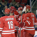 Carolina Hurricanes' Eric Staal, second from right, celebrates his goal with Elias Lindholm (16), of Sweden, Jordan Staal (11) and John-Michael Liles, rear, during the second period of an NHL hockey game against the Buffalo Sabres in Raleigh, N.C., Thursd
