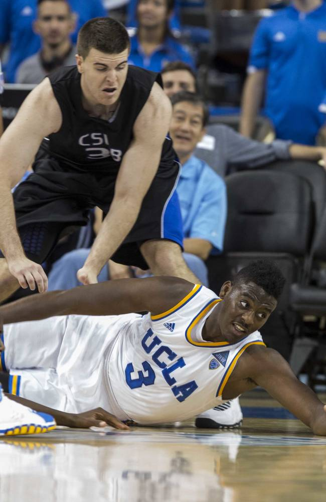 UCLA's Jordan Adams (3) tries to reach a loose ball against Cal State San Bernardino's Casey Oldemoppen in the second half of an NCAA college exhibition  basketball game on Wednesday, Oct. 30, 2013, in Los Angeles. UCLA won 96-66