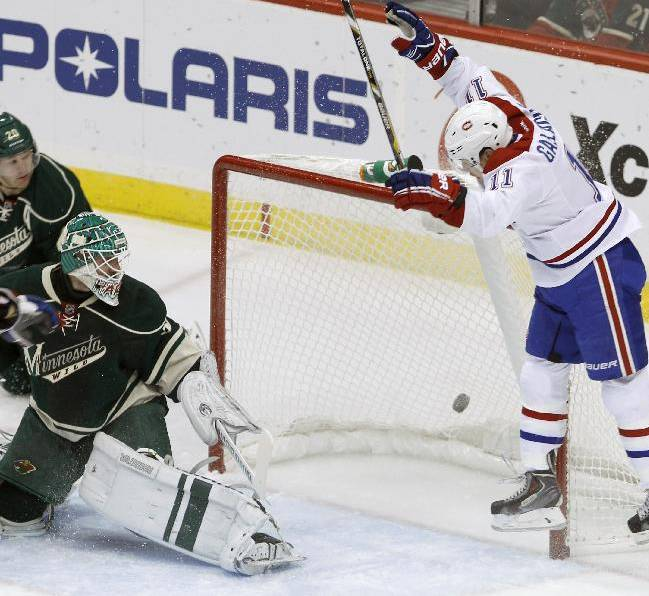 Montreal Canadiens right wing Brendan Gallagher (11) reacts after scoring on Minnesota Wild goalie Josh Harding, left, during the first period of an NHL hockey game in St. Paul, Minn., Friday, Nov. 1, 2013