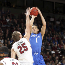 Kentucky guard Devin Booker (1) shoots a jump shot over South Carolina's Mindaugas Kacinas (25) in the first half of an NCAA college basketball game, Saturday, Jan. 24, 2015, at the Colonial Life Arena in Columbia, S.C. (AP Photo/Willis Glassgow)