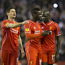 Liverpool's Mario Balotelli, centre, applauds supporters as teammates Dejan Lovren, left, and Mamadou Sakho look on after the Europa League Round of 32 soccer match between Liverpool and Besiktas at Anfield Stadium in Liverpool, England, Thursday, Feb. 19