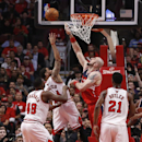 Chicago Bulls guard D.J. Augustin (14) shoots over Washington Wizards center Marcin Gortat (4) as Nazr Mohammed (48) and Jimmy Butler (21) watch during the first half of Game 2 in an opening-round NBA basketball playoff series Tuesday, April 22, 2014, in