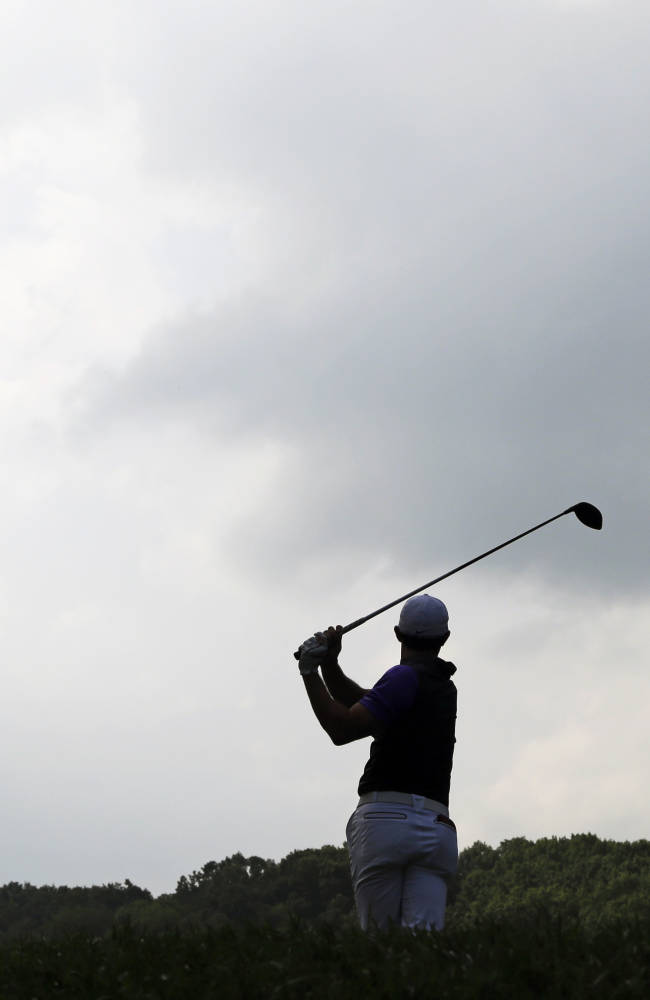McIlroy wins PGA in thrilling show on soggy turf