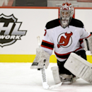 Anthohny Brodeur, son of New Jersey Devils' goalkeeper Martin Brodeur, stretches during Devils rookies NHL hockey camp, Tuesday, July 15, 2014, in Newark, N.J. Anthony Brodeur, 19, is participating along with his younger brothers, twins Jeremy Brodeur and
