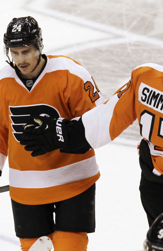 Philadelphia Flyers' Matt Read (24) is congratulated by Wayne Simmonds (17) after scoring against the New York Islanders in the third period of an NHL hockey game, Saturday, Nov. 23, 2013, in Philadelphia.  Flyers won 5-2