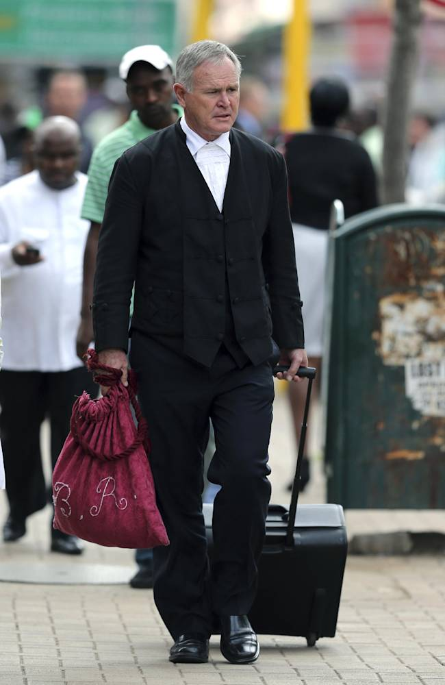 Barry Roux, the lawyer defending Oscar Pistorius, arrives at the high court in Pretoria, South Africa, Tuesday, March 25, 2014. Pistorius is charged with murder for the shooting death of his girlfriend Reeva Steenkamp on Valentine's Day in 2013. (AP Photo/Themba Hadebe)