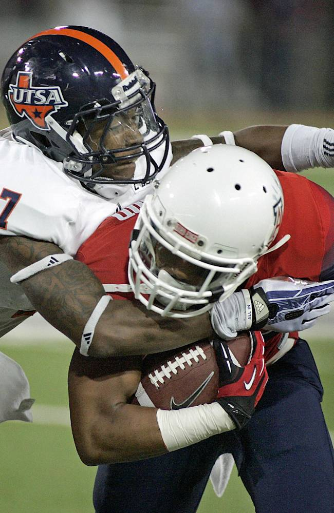 Texas San Antonio's Triston Wade (7) drags down Arizona's Johnny Jackson, right, after a short gain in the first half of an NCAA collge football game on Saturday, Sept. 14, 2013, in Tucson, Ariz