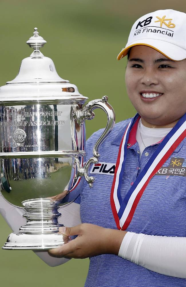 In this June 30, 2013 file photo, Inbee Park, of South Korea, holds the championship trophy after winning the U.S. Women's Open golf tournament at the Sebonack Golf Club in Southampton, N.Y. Park will seek to regain her dominant form with a strong showing at the inaugural Reignwood LPGA Classic in Beijing. Park, the world No. 1, is being joined by third-ranked American Stacy Lewis at the tournament, which begins Thursday, Oct. 3, 2013