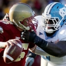 FILE - In this file photo taken Nov. 21, 2009, North Carolina's Marvin Austin (9) sacks Boston College quarter in Boston. Austin made some of his first extended comments since missing his senior season in connection with an agent scandal on Thursday, Jan. 20, 2011, following his final walkthrough in preparation for Saturday's East-West Shrine Game in Orlando. It is the first major college football all-star game of the 2010 postseason for potential pro prospects. (AP Photo/Michael Dwyer)