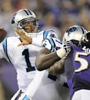 Carolina Panthers quarterback Cam Newton looks for an open receiver during the first half of a preseason NFL football game against the Baltimore Ravens in Baltimore, Thursday Aug. 22, 2013. (AP Photo/Nick Wass)
