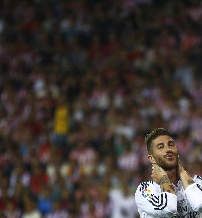 Real's Sergio Ramos gestures after missing a chance during a Spanish Supercup second leg soccer match between Real Madrid and Atletico Madrid at Vicente Calderon stadium in Madrid, Spain, early Saturday, Aug. 23, 2014
