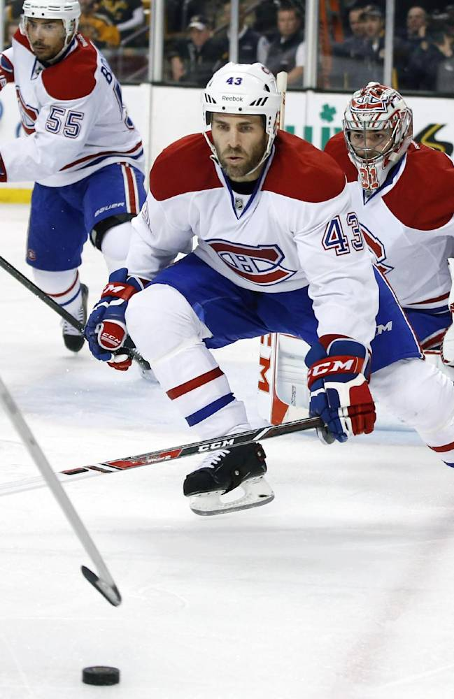 Montreal Canadiens defenseman Mike Weaver (43) helps defend the net against the Boston Bruins along with goalie Carey Price (31) during the second period in Game 1 of an NHL hockey second-round playoff series in Boston, Thursday, May 1, 2014