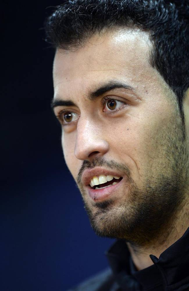 FC Barcelona's Sergio Busquets attends a press conference at the Sports Center FC Barcelona Joan Gamper in San Joan Despi, Spain, Tuesday, Dec. 10, 2013. FC Barcelona will play against Celtic in a group H Champions League next Wednesday Dec. 11