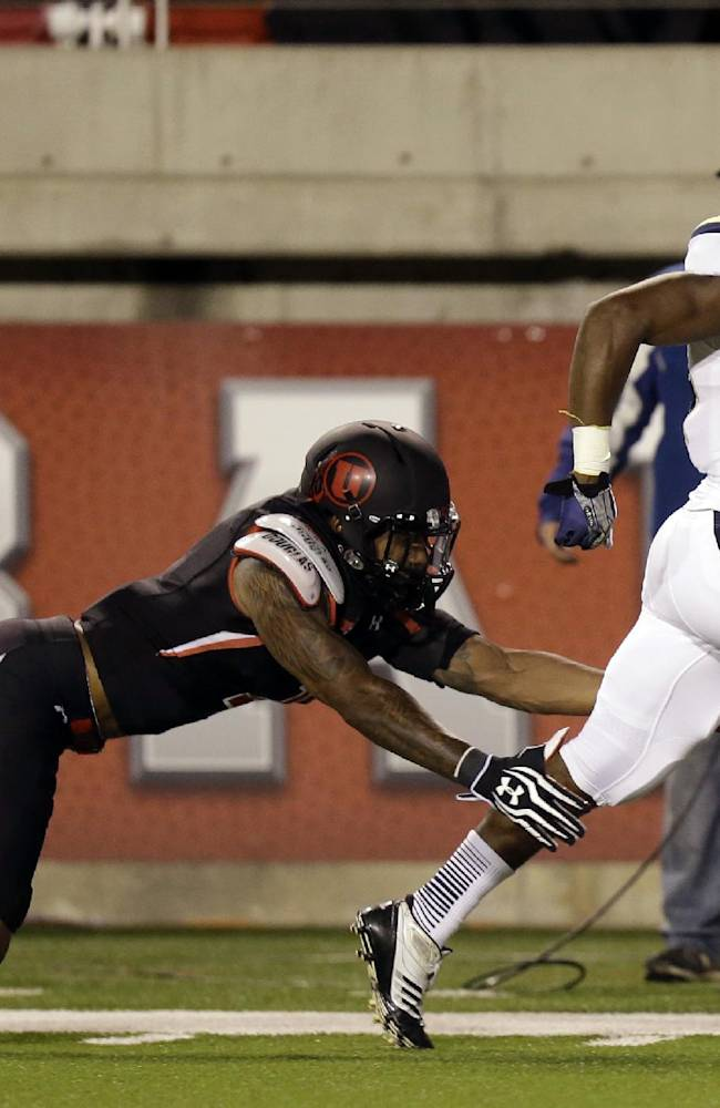 UCLA running back Paul Perkins (24) outruns Utah defensive back Keith McGill, left, in the first quarter during an NCAA college football game on Thursday, Oct. 3, 2013, in Salt Lake City