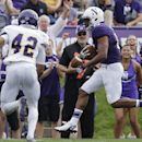 Northwestern running back Solomon Vault (15), right, scores a touchdown against Western Illinois defensive back Myles Spearman (42) during the first half of an NCAA college football game in Evanston, Ill., Saturday, Sept. 20, 2014 The Associated Press