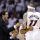 Miami Heat forward Chris Andersen (11) is restrained by official Marc Davis as coach Erik Spoelstra yells at him during the first half of Game 5 in the NBA basketball playoffs Eastern Conference finals against the Indiana Pacers, Thursday, May 30, 2013, in Miami. Andersen was charged with a flagrant foul. (AP Photo/Lynne Sladky)
