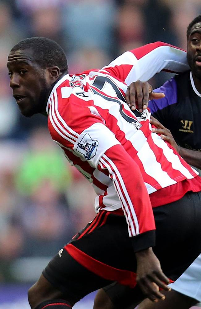 Sunderland's Jozy Altidore, left, in action with Liverpool's Kolo Toure, right, during their English Premier League soccer match at the Stadium of Light, Sunderland, England, Sunday, Sept. 29, 2013