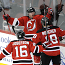 New Jersey Devils' Michael Ryder celebrates his goal with Reid Boucher (18) and Jacob Josefson (16) during the third period of an NHL hockey game against the Winnipeg Jets Thursday, Oct. 30, 2014, in Newark, N.J. The Devils won 2-1 in a shootout The Assoc