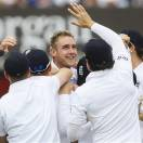 England's Stuart Broad, centre, celebrates the wicket of New Zealand's captain Brendon McCullum in their first test match, at Lord's cricket ground in London, Sunday, May 19, 2013. (AP Photo/Kirsty Wigglesworth)
