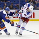 New York Islanders defenseman Brian Strait (37) defends on a shot by New York Rangers center Dominic Moore (28) in the third period of an NHL hockey game in Uniondale, Tuesday, Jan. 27, 2015. The Islanders defeated the Rangers 4-1 The Associated Press
