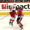 Chicago Blackhawks' Jonathan Toews sidesteps a check attempt by Detroit Red Wings' Tomas Nosek during the third period in an NHL exhibition hockey game in Chicago on Tuesday, Sept. 23, 2014. The Blackhawks won 2-1 in overtime. The Associated Press