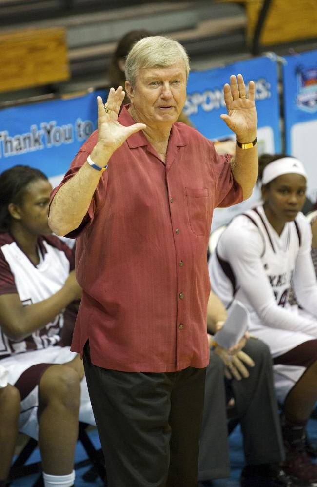 Texas A&M head coach Gary Blair gives instructions to his players during the first half of an NCAA college basketball game against Memphis in St. Thomas, U.S. Virgin Islands, Thursday, Nov. 28, 2013