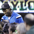 Washington Redskins quarterback and Baylor alumni Robert Griffin III chats with press row during the second half of an NCAA college basketball game between Oklahoma and Baylor, Monday, Feb. 24, 2014, in Waco, Texas The Associated Press