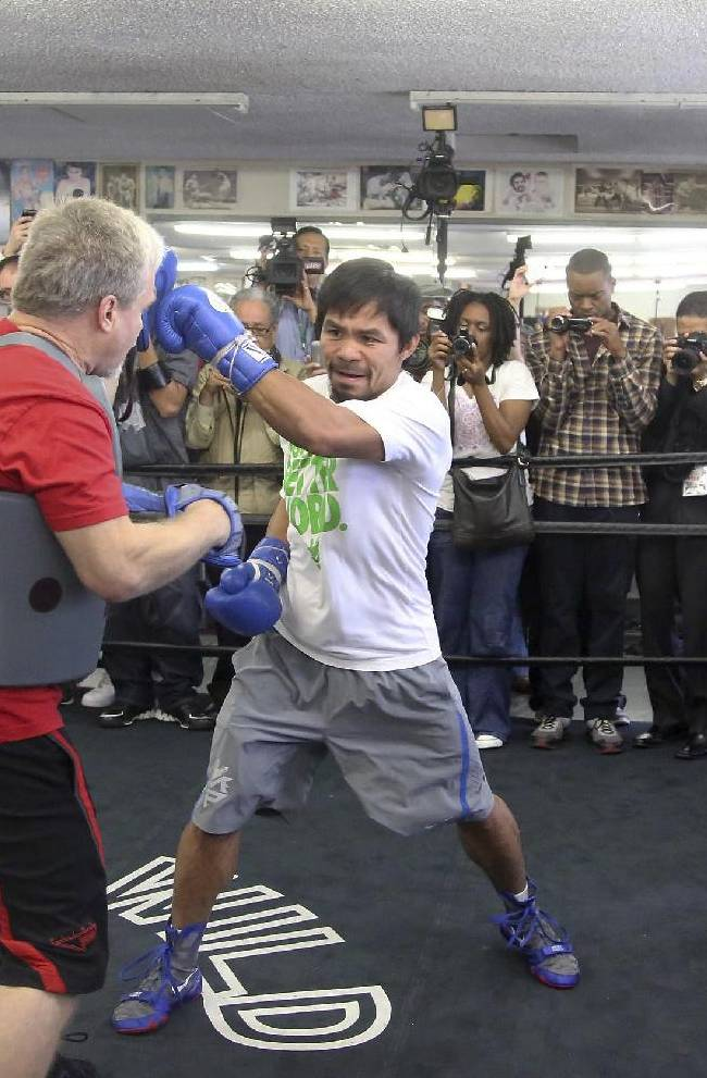 Manny Pacquiao trains with coach Freddie Roach on Wednesday, April 2, 2014, in Los Angeles. Pacquiao is scheduled to fight Timothy Bradley on April 12 in a WBO welterweight title bout